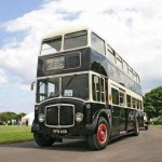Vintage bus to carry the coffin and mourners
